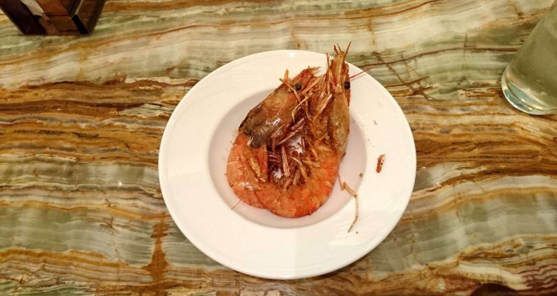 Delicious Salt & Pepper Prawns are one of the signature dishes served by LV Buffet. Note the colorful stone dining table.