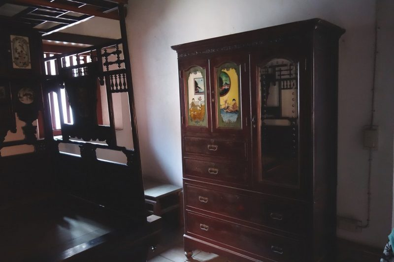 A chinese wardrobe - chest of drawers.
